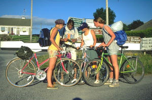 Group of cyclists looking at map